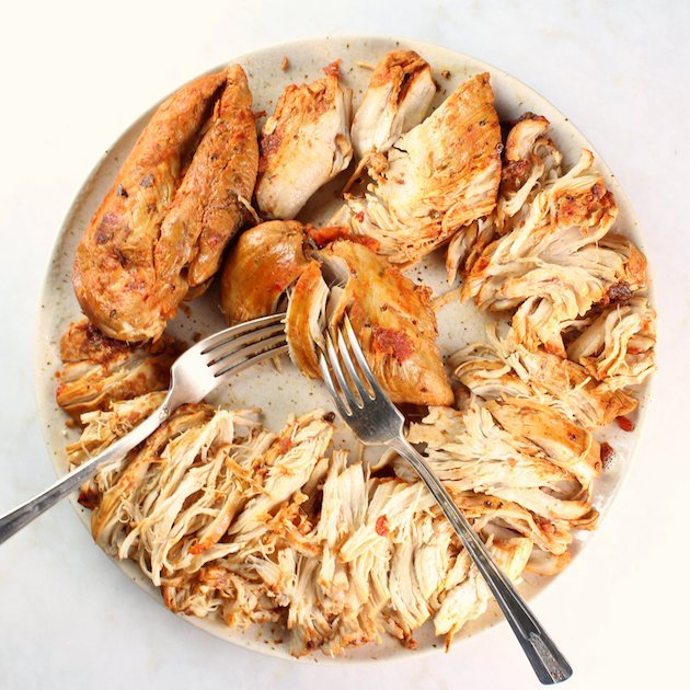 Shredded Mexican Chicken (Instant Pot + Slow Cooker) Full Plate of Cooked Chicken Over Top