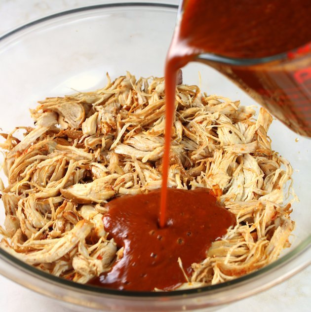 Shredded Mexican Chicken (Instant Pot + Slow Cooker) Sauce Pouring Over Bowl Of Chicken