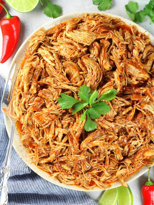 Shredded Mexican Chicken (Instant Pot + Slow Cooker) Partial Plate of Chicken Over Top