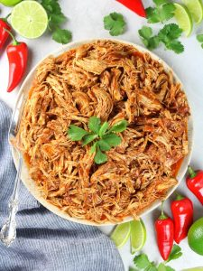 Shredded Mexican Chicken (Instant Pot + Slow Cooker) Full Plate of Chicken Over Top
