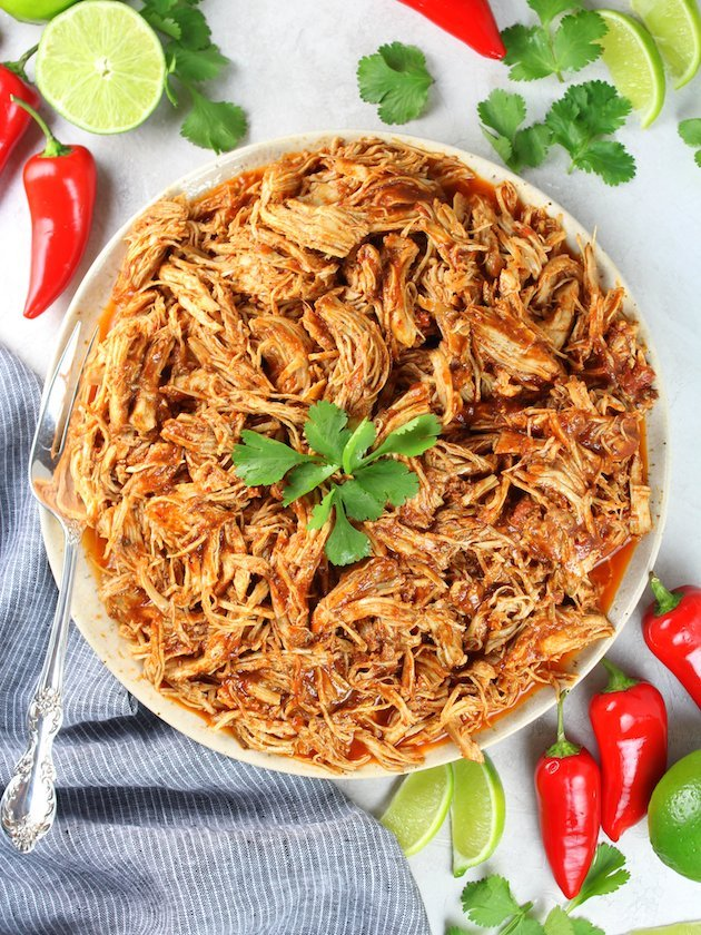 Mexican chicken casserole taste and see shredded mexican chicken instant pot slow cooker full plate of chicken over top forumfinder Choice Image