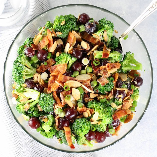 Broccoli Bacon Grape salad in a glass bowl