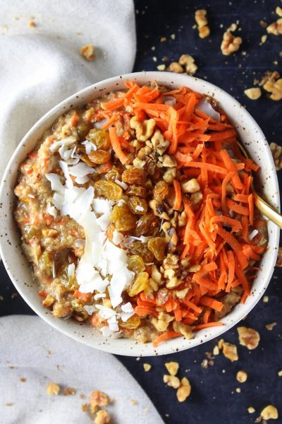 Breakfast bowl with carrots, oats, nuts, coconut