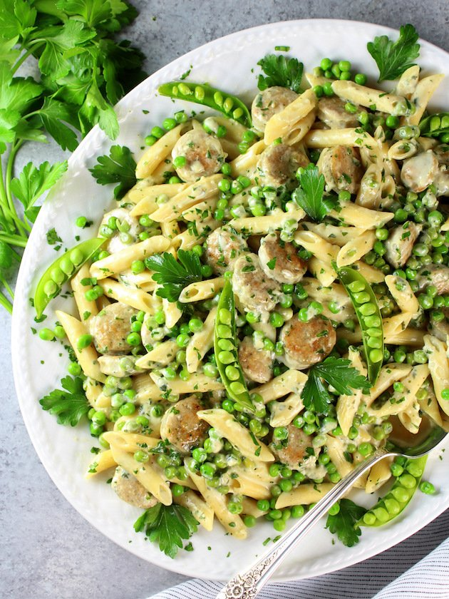 Chicken Alfredo with Penne and Peas over top platter