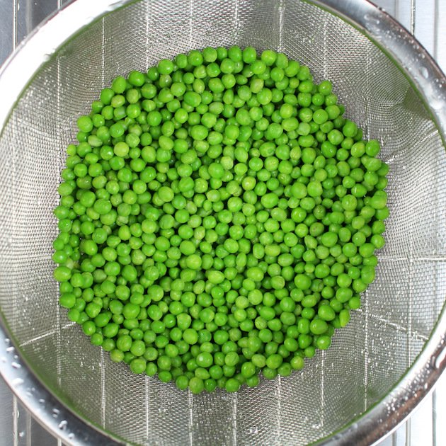 peas in a strainer