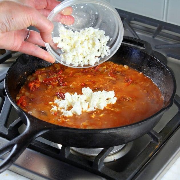 Adding Feta To Sauce On Stove