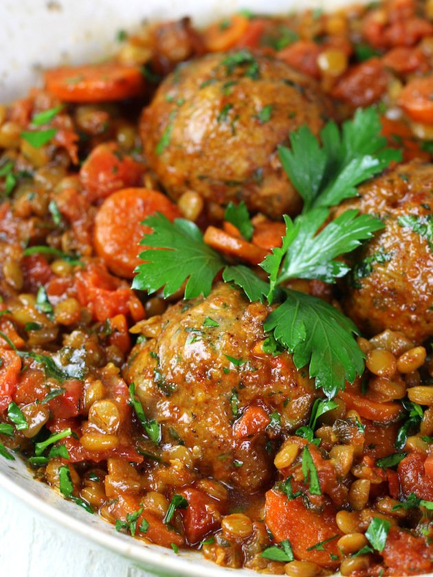 A dish filled with Meatballs and Lentils