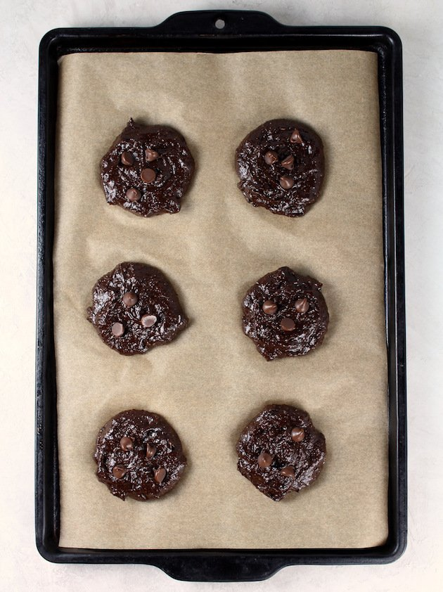 Double Chocolate Protein Cookies Recipe & Image: Cookies on parchment sheet before baking