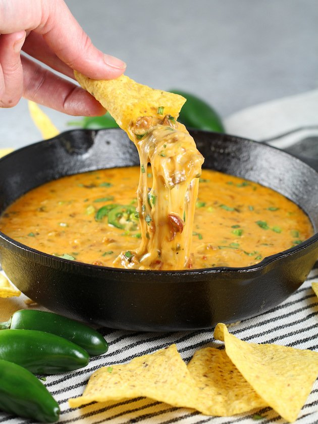 Queso Fundido with Chorizo Recipe and Image - chip with cheesy dip