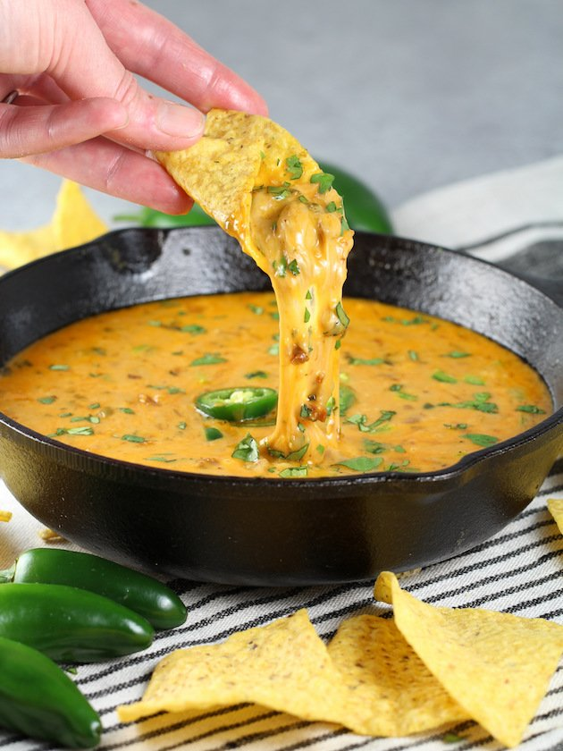 Queso Fundido with Chorizo Recipe and Image - pan with chip dipped