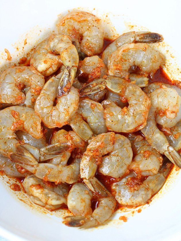 Grilled Chili Lime Shrimp Recipe & Image: Shrimp in bowl tossed in marinade