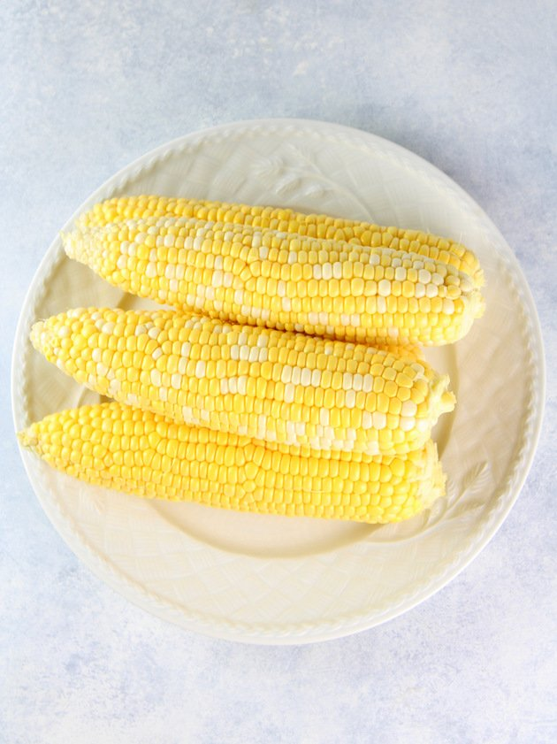 Grilled Veggies and Corn Salad with White Balsamic Dressing Recipe & Image: Boiled corn on platter