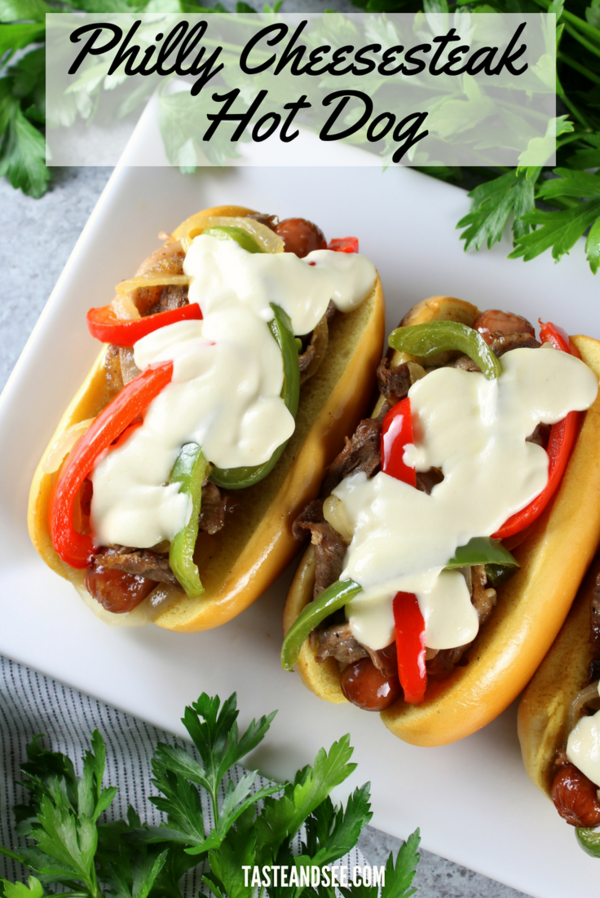 Philly Cheese Steak Hot Dog - With sautéed onions & peppers, thinly shaved steak, an all-beef hot dog, and a creamy provolone garlic cheese sauce! The perfect summertime grilling sensation!  #grilling #cheesesteak #philly #steak #cheese #hotdog    https://tasteandsee.com   