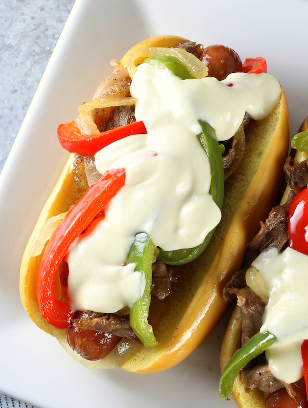 Philly Cheesesteak Hot Dog Recipe & Image: up close OT single sandwich with cheese sauce