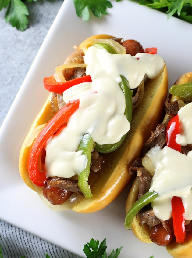 Philly Cheesesteak Hot Dog Recipe & Image: Close up OT cheesesteak with cheese sauce