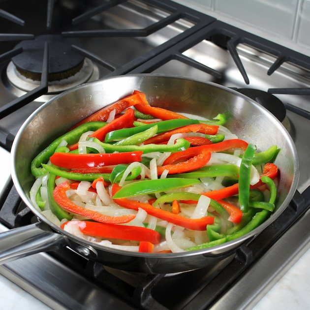 Philly Cheesesteak Hot Dog Recipe & Image: Cooking onions & peppers in saute pan
