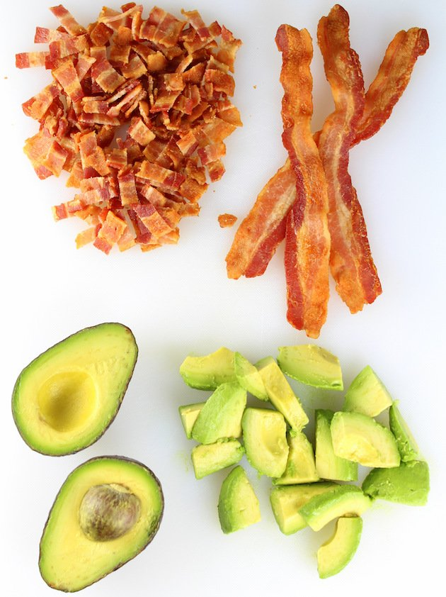 BBQ Chicken Bacon Ranch Pasta Salad Recipe & Image: chopped bacon and sliced avocado on cutting board