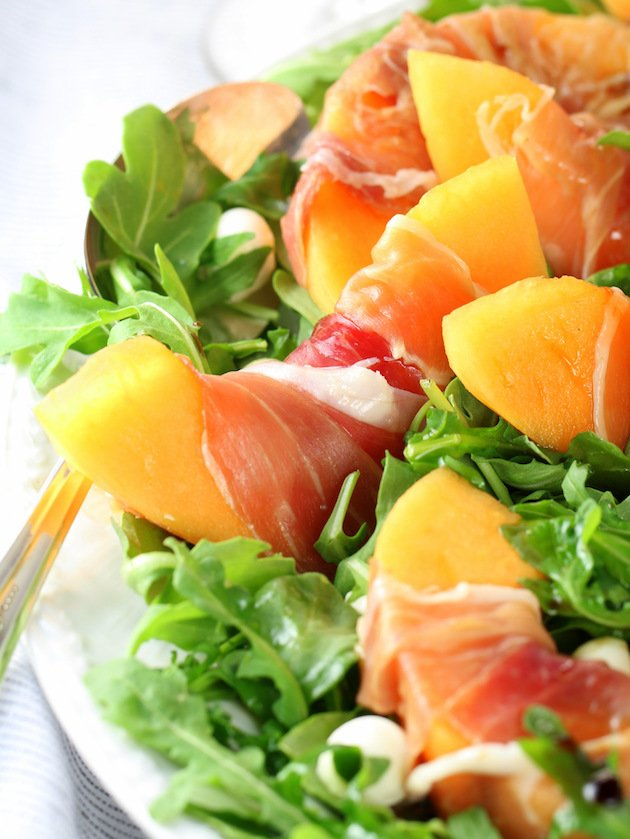 Melon Mozzarella Prosciutto Salad with Arugula Recipe & Image: Partial Platter of salad EL Close Up