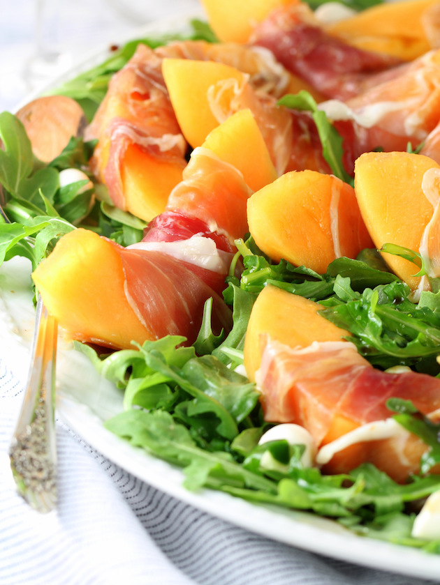 Melon Mozzarella Prosciutto Salad with Arugula Recipe & Image: Partial platter of salad EL