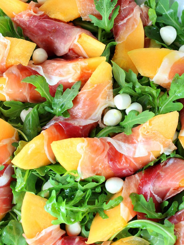 Melon Mozzarella Prosciutto Salad with Arugula Recipe & Image: Platter of salad OT Close Up