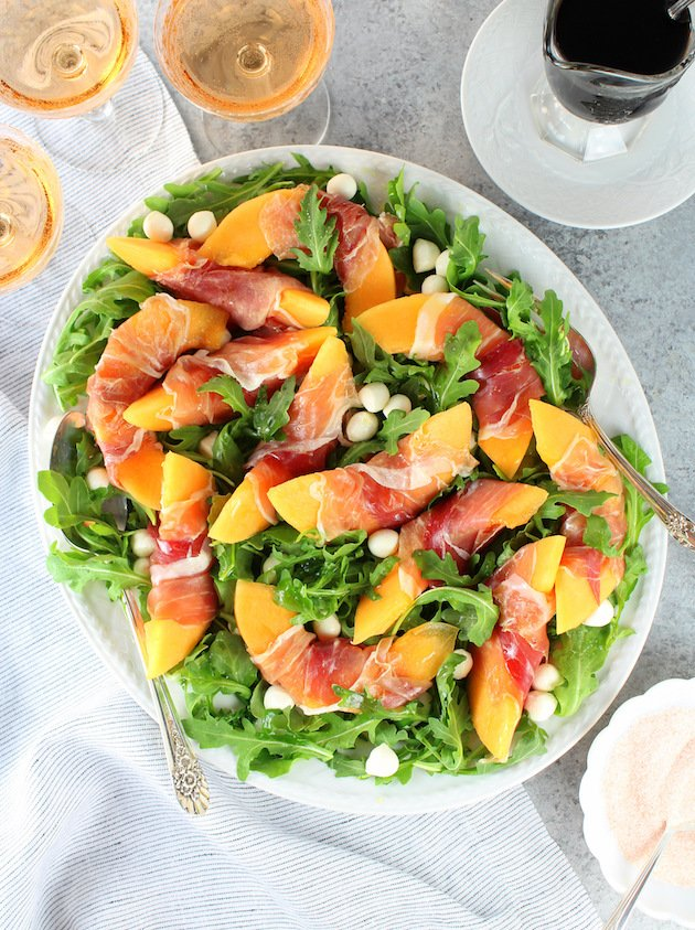 Melon Mozzarella Prosciutto Salad with Arugula Recipe & Image: Platter of salad OT