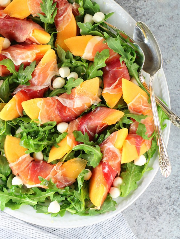 Melon Mozzarella Prosciutto Salad with Arugula Recipe & Image: Partial platter of salad OT