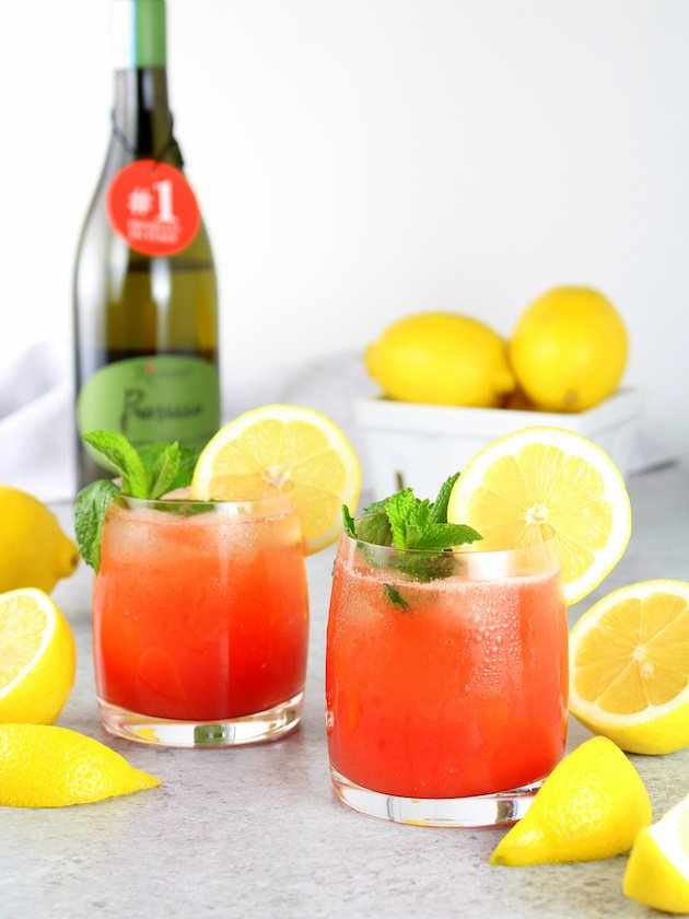 Watermelon Lemonade Prosecco Spritzer Recipe & Image: two glasses with prosecco in background