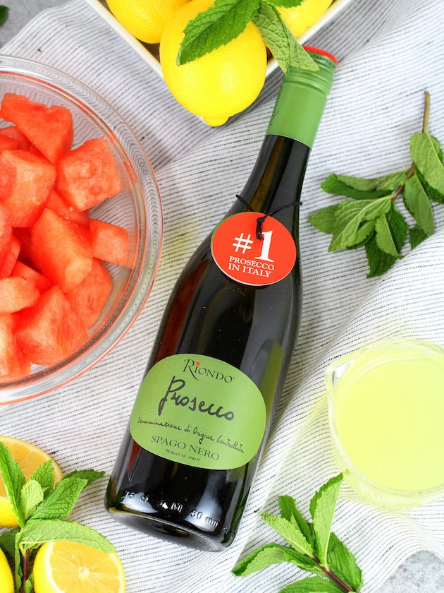 Watermelon Lemonade Prosecco Spritzer Recipe & Image: Riondo Prosecco bottle and ingredients