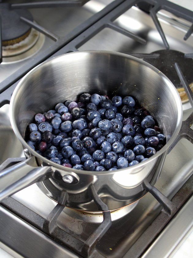Blueberry Lemon No Bake Cheesecake Jars Recipe & Image: Blueberries cooking in saucepan on stove