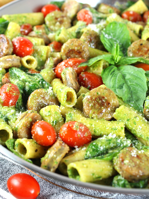 One Pot Creamy Chicken Pesto Pasta Recipe & Image: pesto chicken pasta up close eye level in pan