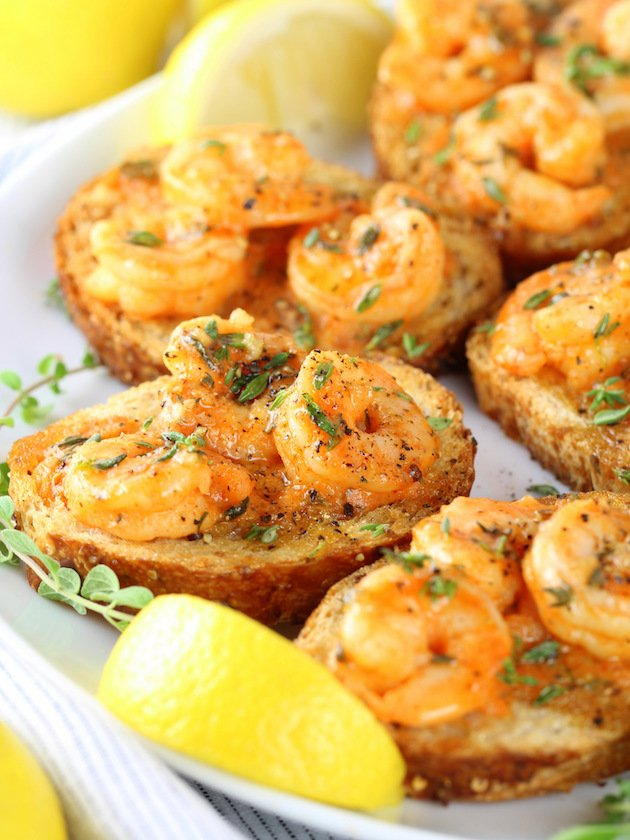 This Easy Cajun Shrimp Toast Appetizer is a super easy and delicious recipe for your next game day soiree!  Tender shrimp coated in creamy garlic sauce with Cajun spices.  #healthy #recipe #gameday #shrimp #football #tasteandsee || https://tasteandsee.com ||