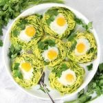 Platter of eggs on zucchini nests