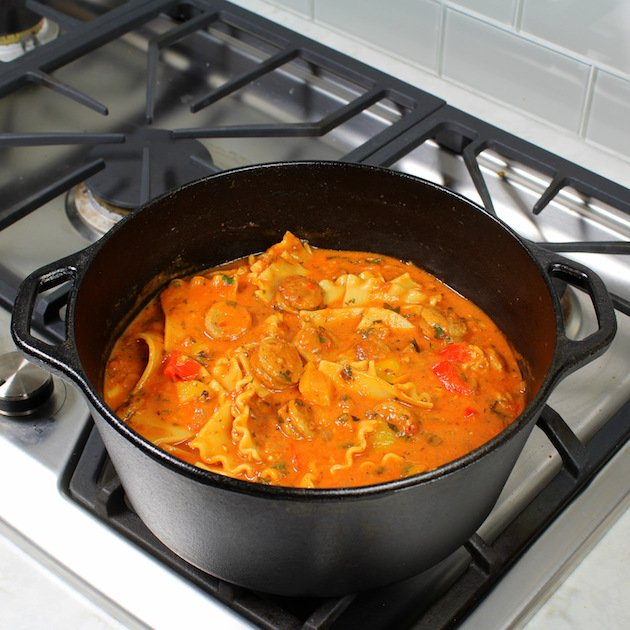 Chicken Sausage Lasagna Soup Cooking in large pot on stovetop
