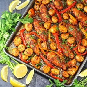 sheet pan dinner with chicken strips and peppers in harissa sauce