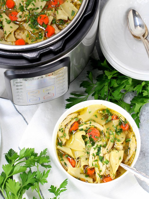 Partial Instant Pot With Bowl Of Chicken Soup