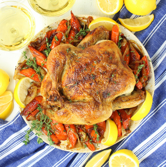 Whole Roasted Chicken on plate with veggies