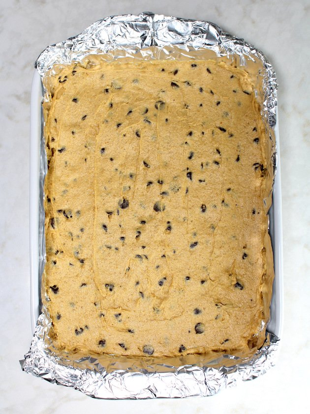 Pumpkin Chocolate Chip Brownies - putting the pumpkin brownie batter in the pan to bake