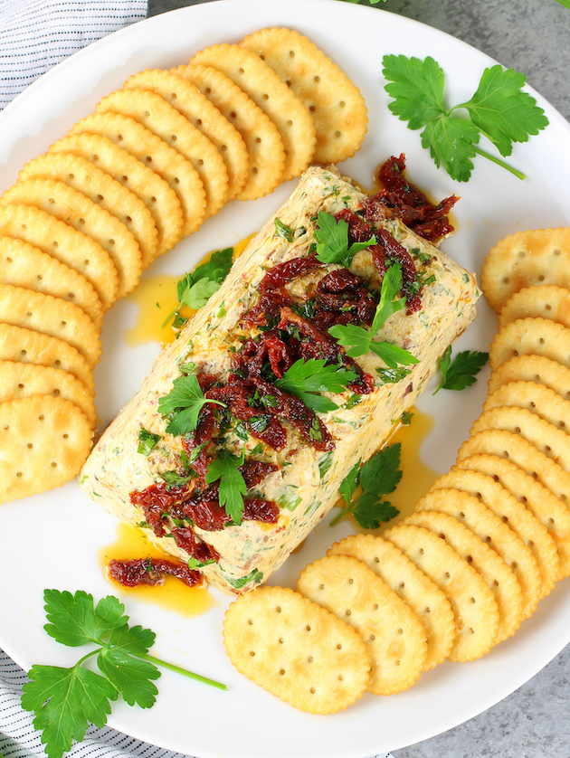 Bacon Ranch Cheese Log Appetizer Recipe and Image - Cheese dip on platter with crackers - wide shot