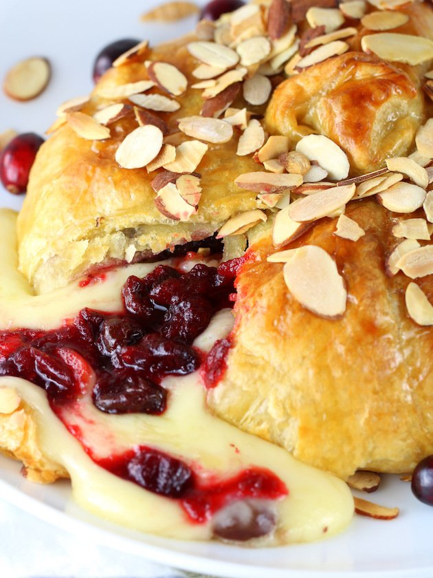 Baked Brie On Plate with Cheese Oozing out