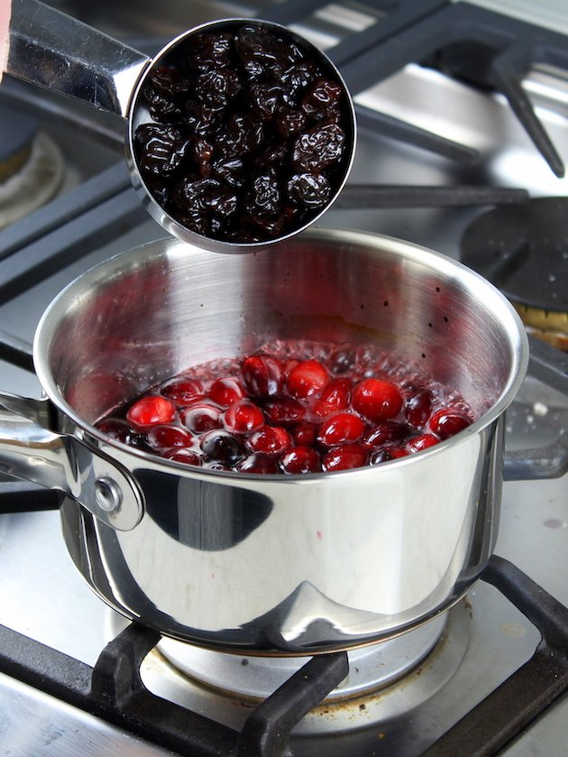 Baked Brie Recipe & Image: adding dried cherries to saucepan