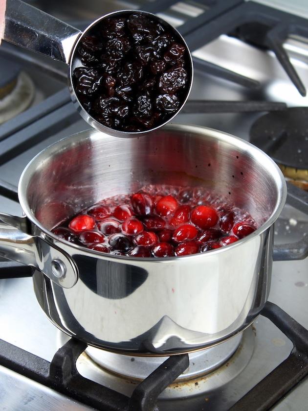 Adding dried cherries to saucepan