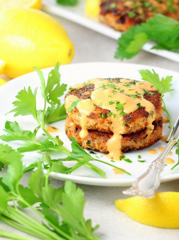 Easy Low Carb Salmon Patty Recipe & Image: salmon patties stacked on plate with aioli