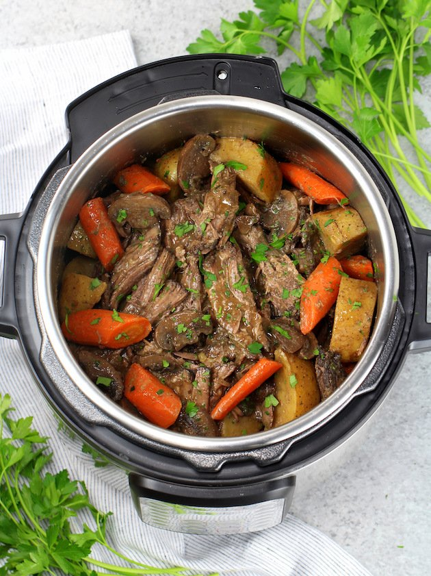 Instant Pot Pot Roast with Veggies and Gravy Recipe & Image: Cooked roast in instant pot