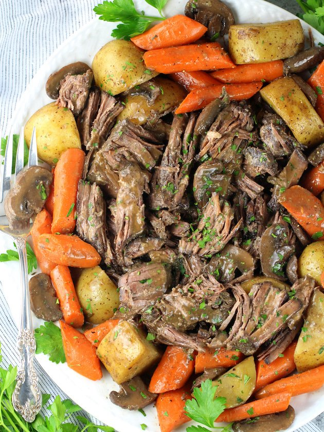 Instant Pot Pot Roast with Veggies and Gravy Recipe & Image: Roast ready to serve on platter