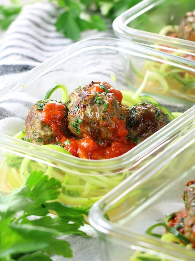 Healthy Meal Prep Baked Turkey Meatballs on zoodles with red sauce in meal prep containers