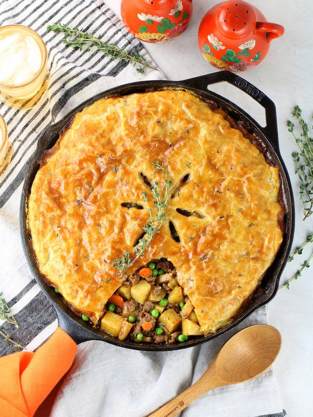 Pot pie with puff pastry in cast iron skillet