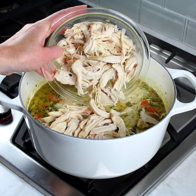 How to make Creamy Tortellini Soup with Chicken - adding shredded chicken to soup