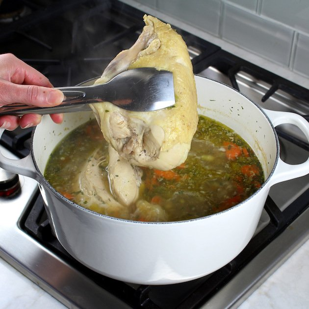 How to make Creamy Tortellini Soup with Chicken - ccoked chicken over soup pot