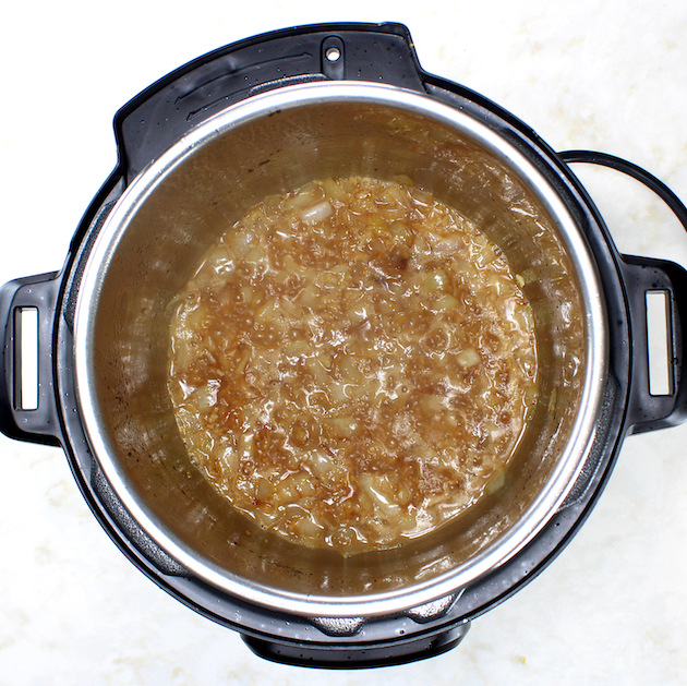 How to make Easy Instant Pot Chicken and Rice - cooking onions and stock in instant pot