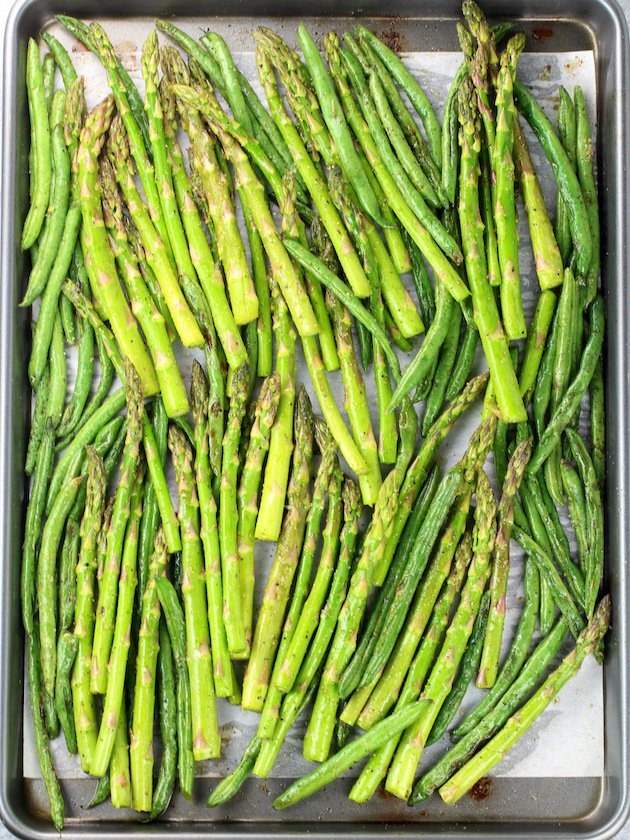 Asparagus Egg and Bacon Salad with Dijon Vinaigrette Image - Roasted Green Beans and Raw Asparagus on Baking Sheet